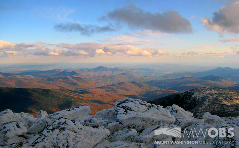 Rime ice on the summit overlooking a sea of fall colors in the Mount Washington Valley.