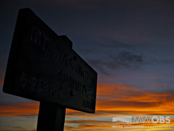 The summit sign with first light at sunrise.