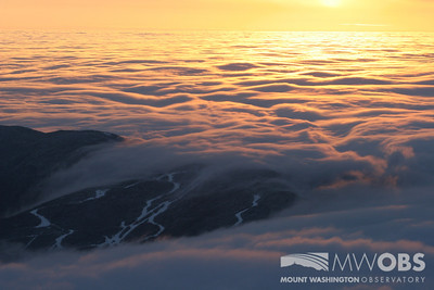 "A sea of clouds ""crashing"" over Wildcat Ski Resort during a winter sunrise."