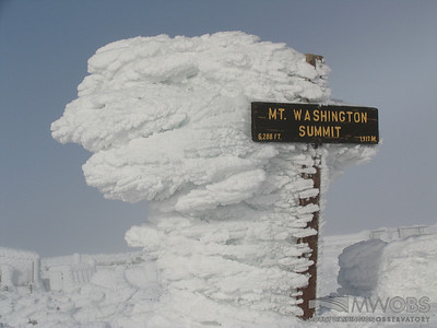 Long feathers of rime on the Mount Washington Summit sign.